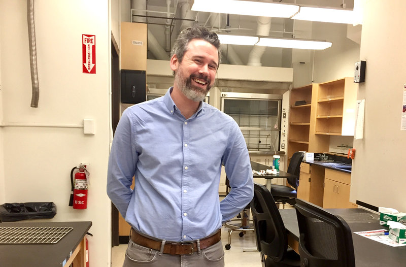 Cancer survivor Michael Inkpen photographed standing in his lab. He smiling and laughing while looking into the camera with his arms behind his back.(Photo: Rhonda Hillbery.)