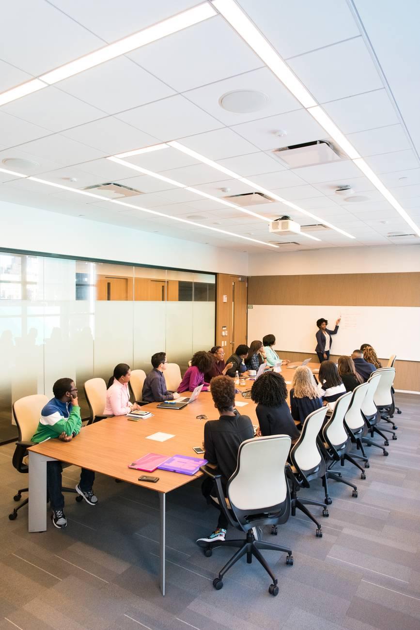 people having meeting inside conference room