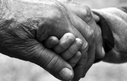 635846254874724826317063541_grandparents-grandmother-grandfather-child-baby-infant-holding-hands-together-love-elderly-senior-citizens-old-age-814x518