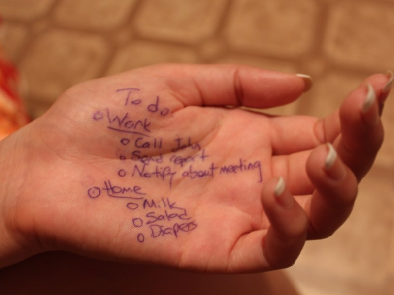 Work and home to-do list written on a female hand