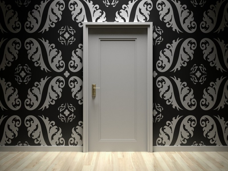 Gray door with black and gray designed wallpaper