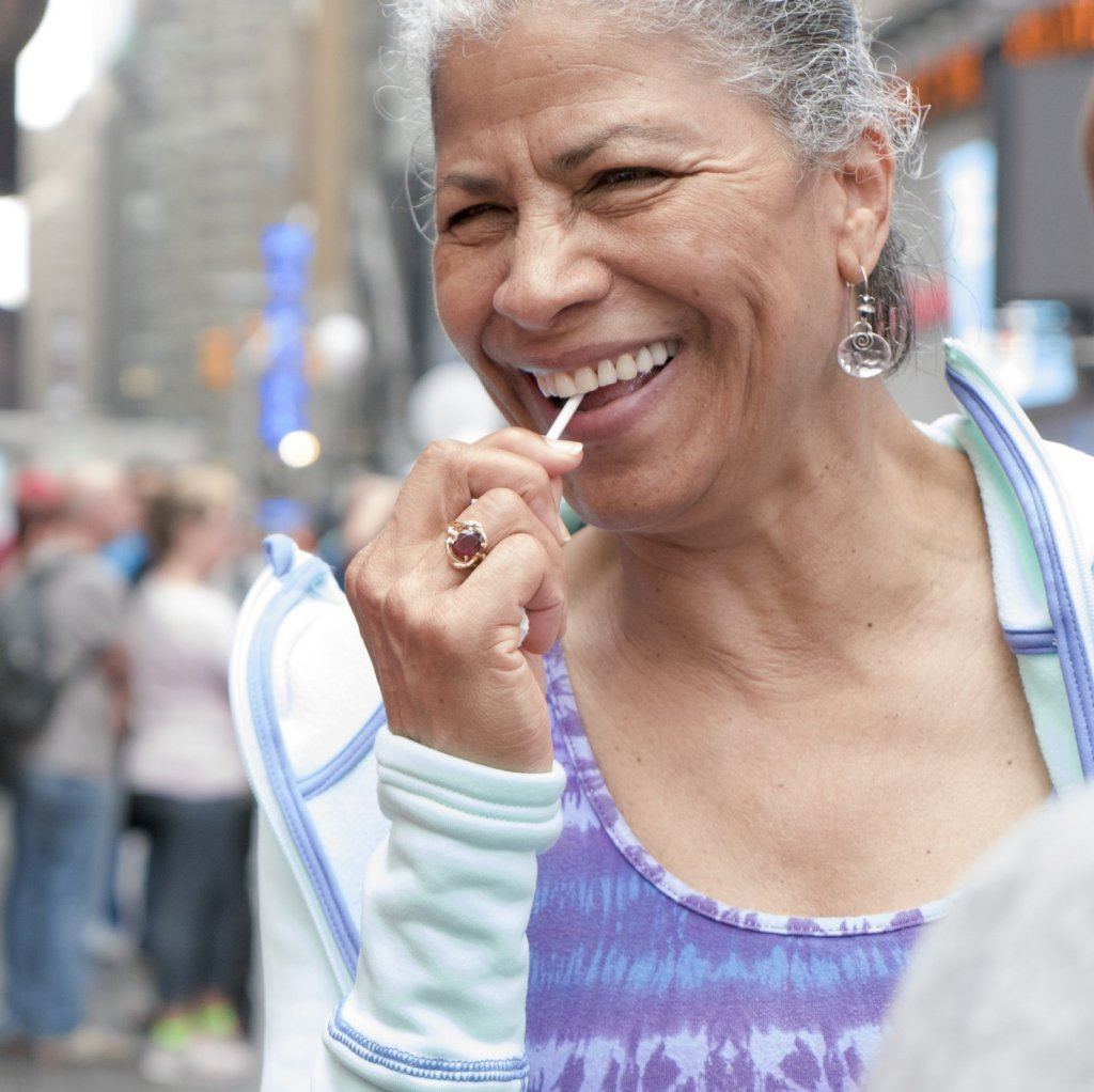 Woman enjoying a Dosha Pops lollipop at NYC's Yoga Summer Solstice