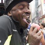 Man enjoying a Dosha Pops lollipop at NYC's Yoga Summer Solstice
