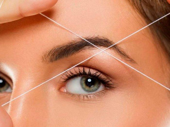 Коррекция бровей ниткой