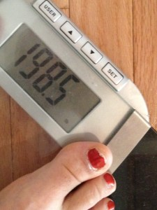 Oh, what a beautiful sight! I was so excited this morning that I did something I don't normally do -- I jumped on my home scale prior to my Weight Watchers meeting.  I just had to know if I landed in Onederland.
