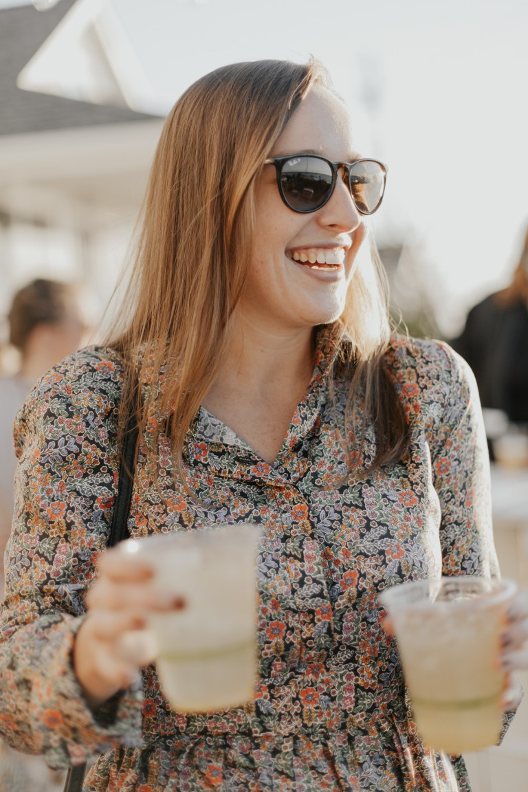 happy woman holding drinks