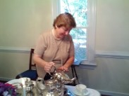 Hostess pouring tea