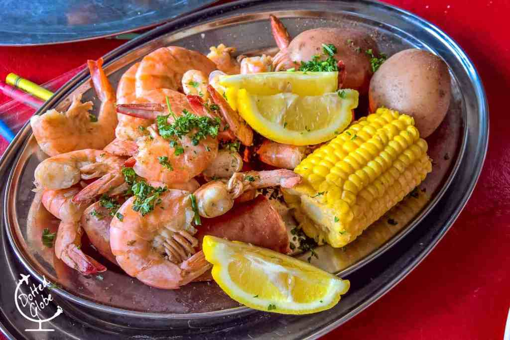 Cajun boiled crawfish and shrimp with corn on the cob and potatoes in New Orleans