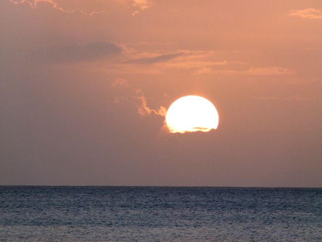 Sunset over the Caribbean Double-Barrelled Travel