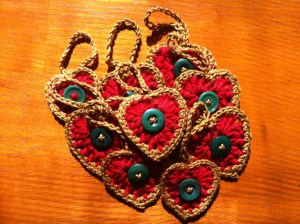 A pile of crocheted heart ornaments