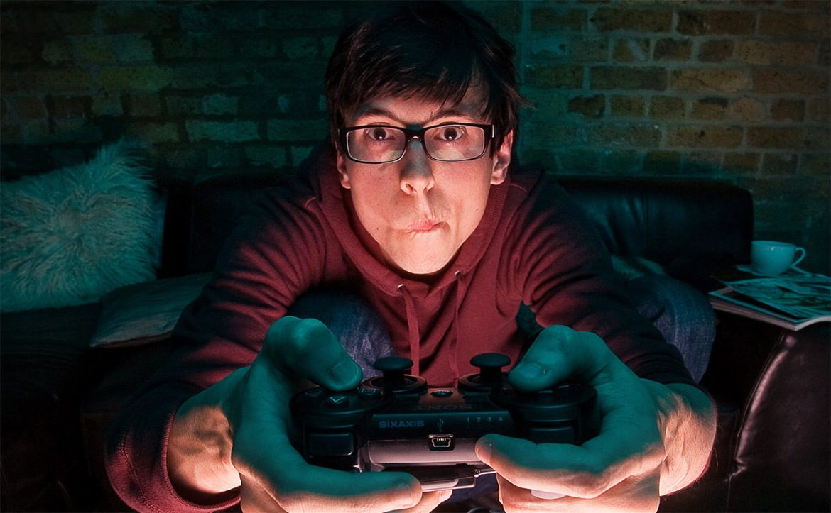 """A """"gamer"""" on a couch."""
