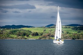 A sailboat catches some sun on Bantry Bay