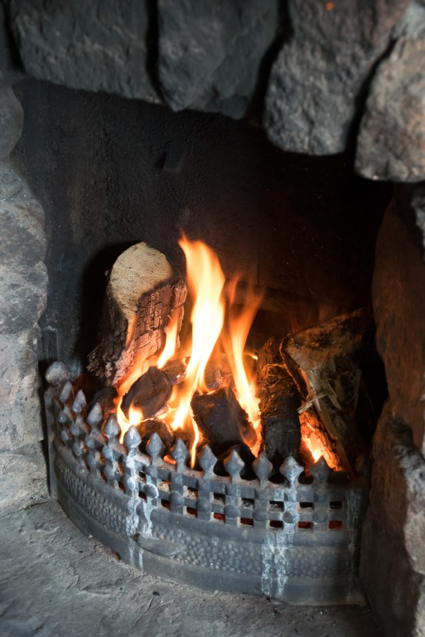 Fireplace burning peat at Leos Tavern