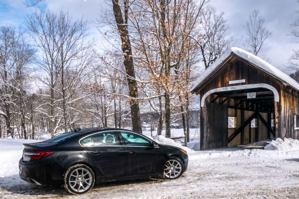 2015 Buick Regal GS AWD driving across covered bridge