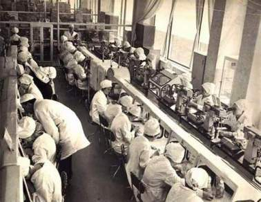 mass production in a dulcimer factory circa 1929