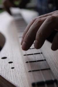 Fingers and fretboard - photo by Mustafa Farhad - dergah.org