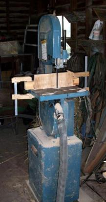 A funky bandsaw in a funky garage on a funky planet.
