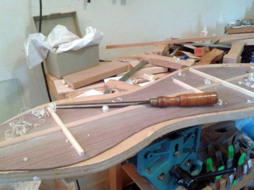 Walnut dulcimer back, paring chisel, and a very neat bench