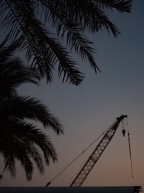 Crane at sunset in Dubai. Olympus 17mm f1.8