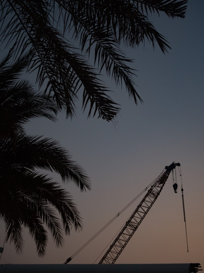 Crane at sunset in Dubai. Olympus 17mm f1.8