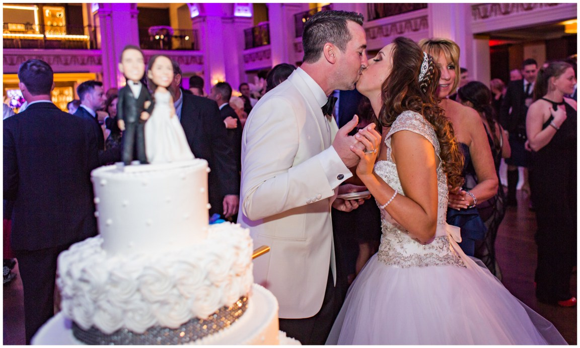 Center City Philadelphia Wedding Bride and groom kissing after cake at the Ballroom at the Ben Philadelphia PA