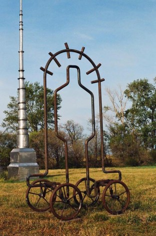 Rolling Man, 2010. Forged iron. 94 x 58 x 35 in.