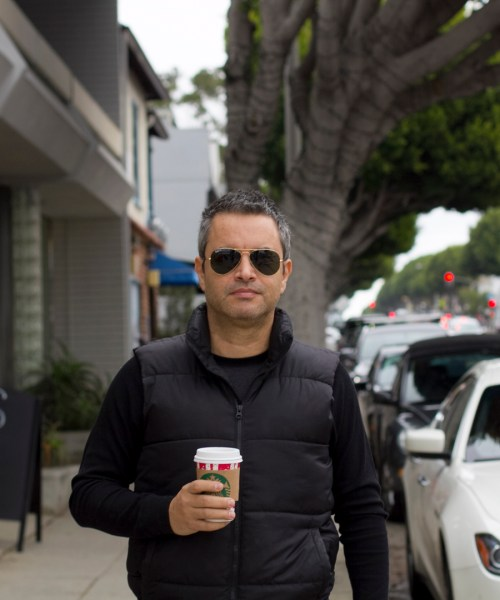 coffee and a black vest