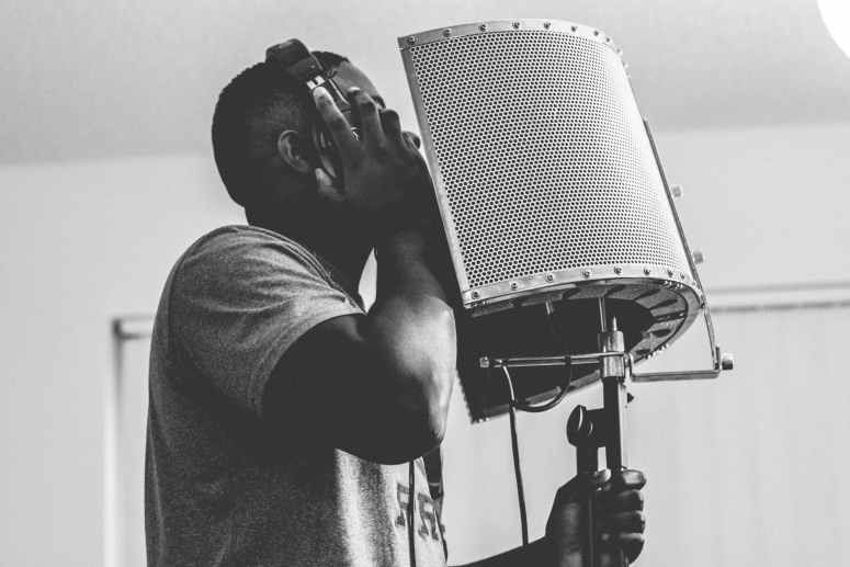 photo of man recording