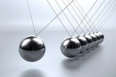 6169600 - metal pendulum balls balancing from strings in newton's cradle