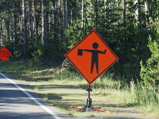 flagman ahead, road sign