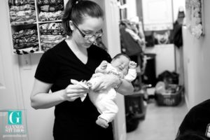 midwife taking baby footprints