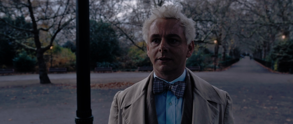 Aziraphale (Sheen) looking hopeful at the idea of running off with Crowley (Crowley).