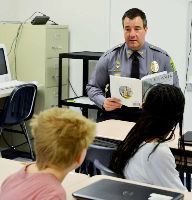 Chief James E. Hosfelt, Jr. takes time to read to a group of 6th grade students for Read Across America.