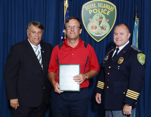 Mr. Gale Voshell accepts the Distinguished Citizen Service Award from Mayor Robin Christiansen and Chief Paul Bernat.