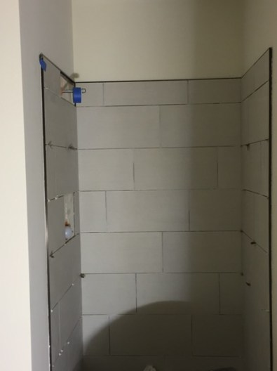Downstairs shower - tile nearly finished!