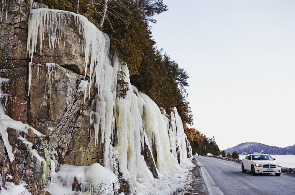 In winter, the ocean itself isn't the only dazzling sight along Sargent Drive. Ice formations on the adjacent cliffs make it tough to keep your eyes on the road.