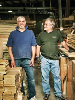 Scott Bogdahn and Mike Lamirande have been coworkers at Maine Woodworks for 20 years.
