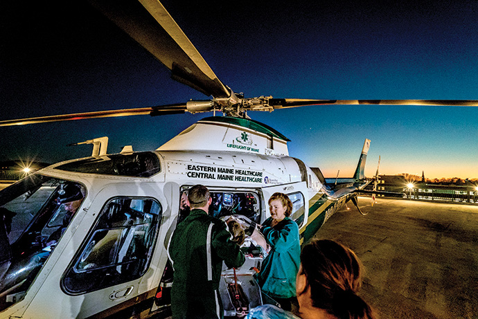 The team arrives with a patient at Eastern Maine Medical Center.