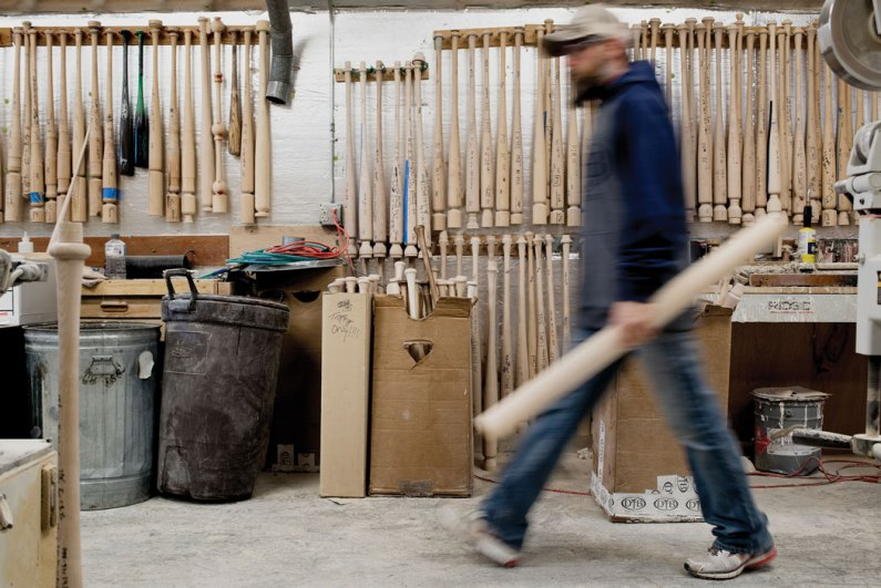 man carrying wood to be carved