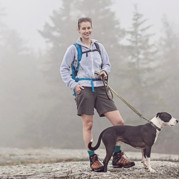 woman walking dog on Great Pond Mountain