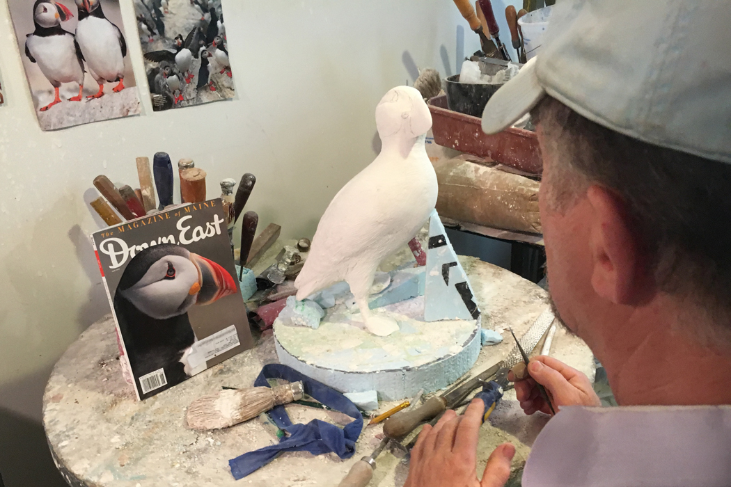 Gary Sussman working on puffin sculpture