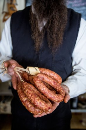 Matthew Secich with sausages