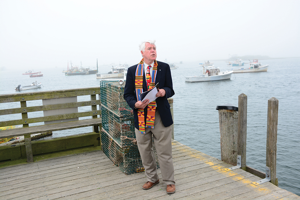 Rev. Charles Whiston, of Kennebunkport's South Congregational Church, presides over the annual blessing of the fleet in Cape Porpoise
