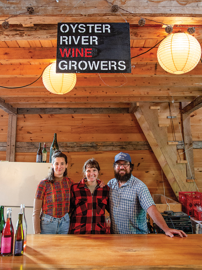 Joanna Spinks, Oyster River creative director, and Oyster River cofounders Allie Willenbrink and Brian Smith share pizza-night bartending duties.