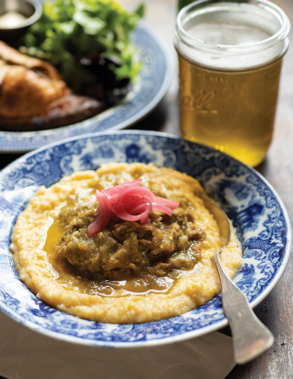 A polenta bowl with pork chile verde