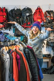 Trying on gently used outdoor gear at Woods + Waters Gear Exchange.