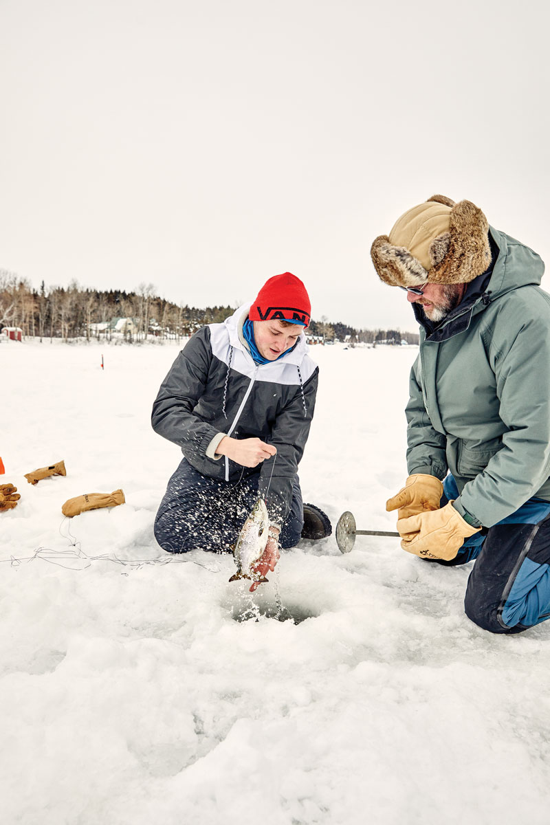 Caleb (left) and Ron Weymouth, of Orrington, pull in a salmon