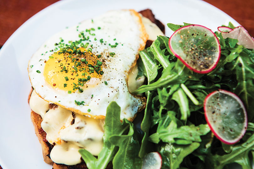 Egg-topped Gruyère- and-mushroom sourdough toast at Eaux