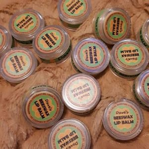 containers of beeswax lip balm