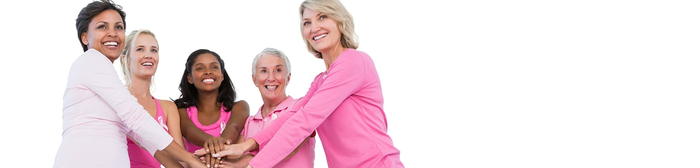 Five older woman wearing pink for breast cancer awareness